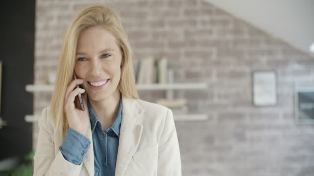 Businesswoman On The Phone Indoors. Closeup of beautiful business woman on the phone indoors, talking and making face expressions (sad, angry, happy). Shot with Sony FS700R with Odyssey7Q Native ProRes422 mid adult stock videos & royalty-free footage