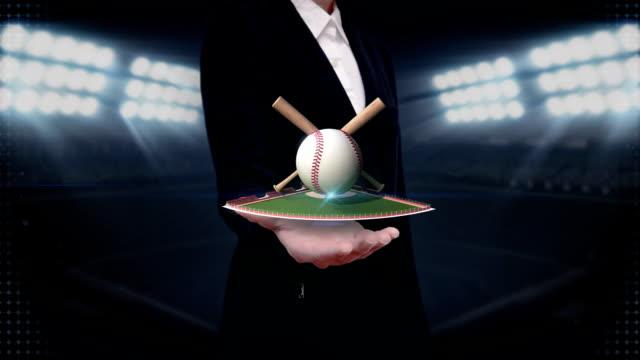 Businesswoman open palm, baseball, bat, ball.field. video