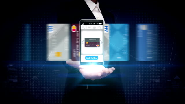 Businesswoman open palm, credit card into smartphone, mobile, concept of mobile payment, mobile credit card. video