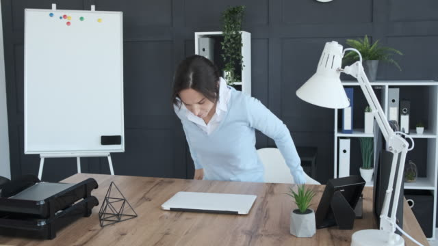 Businesswoman packing her belongings in carton box and leaving office