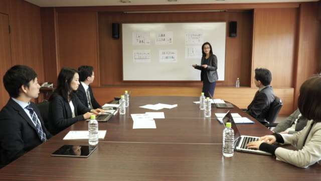 Businesswoman presenting in meeting room Business team working in meeting room east asia stock videos & royalty-free footage