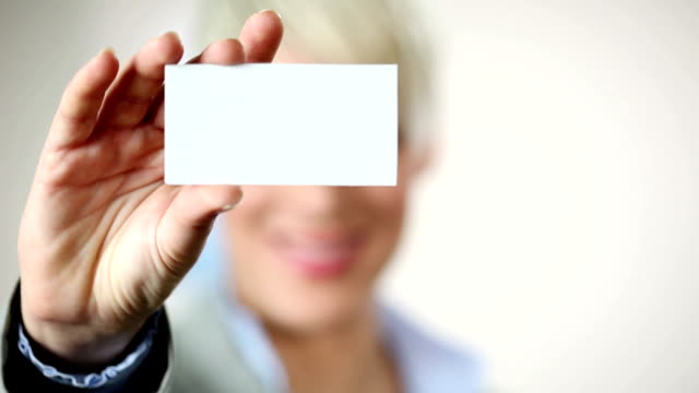 businesswoman showing card. - business card stock videos & royalty-free footage