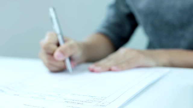 Businesswoman signing a document video