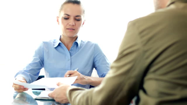 Businesswoman signing contract with male client video