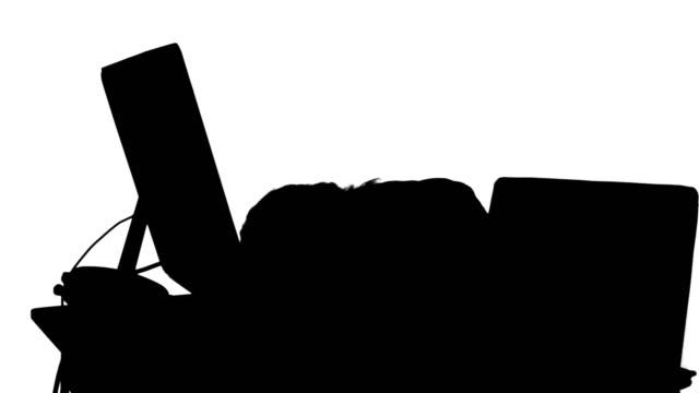 businesswoman sleeping on her desk silhouette - blazer bildbanksvideor och videomaterial från bakom kulisserna