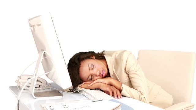 businesswoman sleeping on her desk - blazer bildbanksvideor och videomaterial från bakom kulisserna