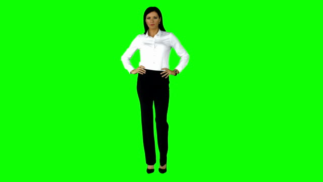 Businesswoman smiling at the camera Businesswoman smiling at the camera on green screen background arms akimbo stock videos & royalty-free footage