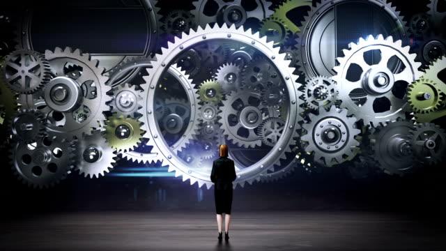 businesswoman standing big gear wheels, connecting gear wheels. - business symbols stock videos & royalty-free footage