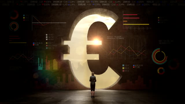 businesswoman standing in front of black wall, shape of a Euro sign.Euro currency.Euro money.with economic diagram video