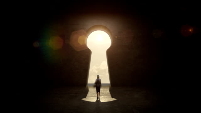 businesswoman Standing in front of Keyhole, black wall concept. video