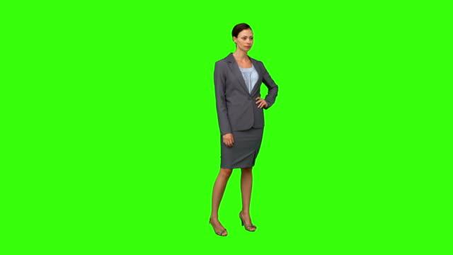 stockvideo's en b-roll-footage met businesswoman standing with hand on hip - handen op de heupen