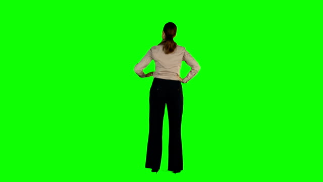 Businesswoman standing with hands on hips Businesswoman standing with hands on hips on green screen background arms akimbo stock videos & royalty-free footage