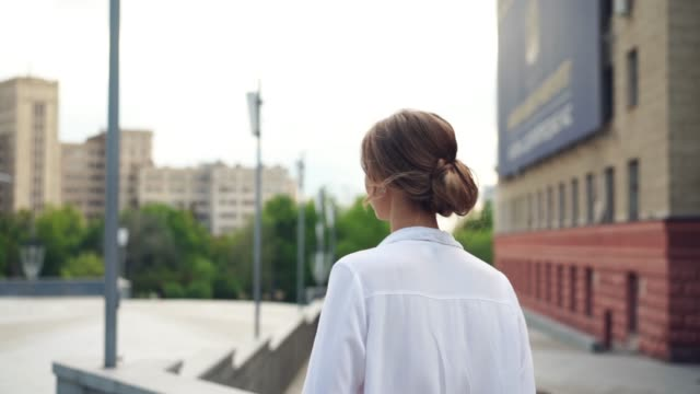 businesswoman successful woman business person standing outdoor corporate building exterior. pensive caucasian confidence professional business woman middle age - eastern european descent stock videos & royalty-free footage
