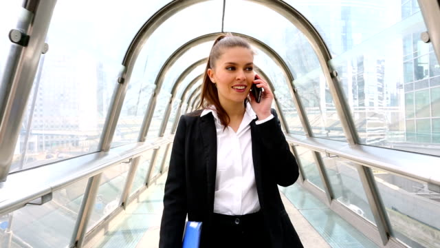 Businesswoman talking on mobile phone in financial district, HD movie (1920X1080, 25 fps) video