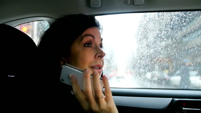 Businesswoman talking on mobile phone video