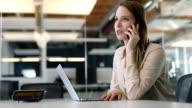 istock Businesswoman talking on smart phone in office 1085386000