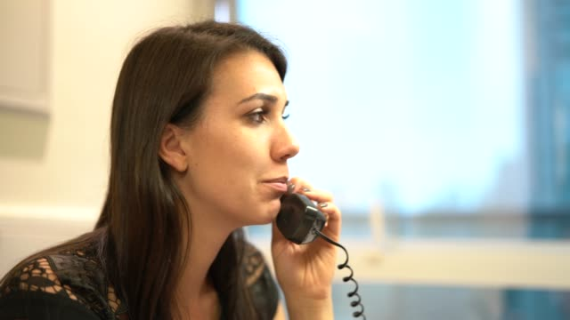 Businesswoman talking on the phone at office Businesswoman landline phone stock videos & royalty-free footage