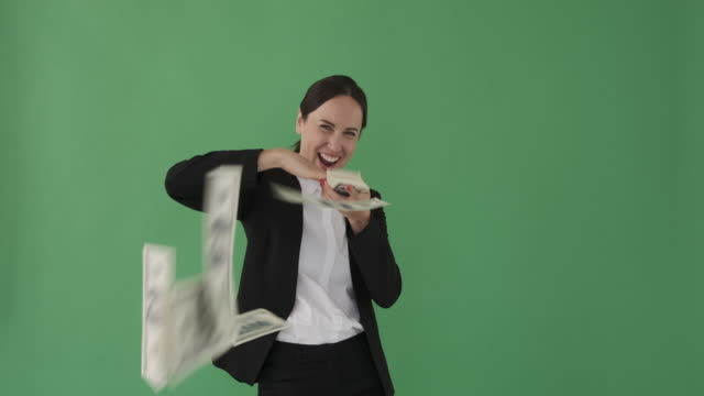 Businesswoman throwing out cash dollars