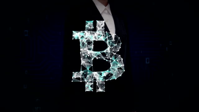 Businesswoman touched screen, Numerous dots gather to create a Bitcoin currency sign, low-polygon web. video
