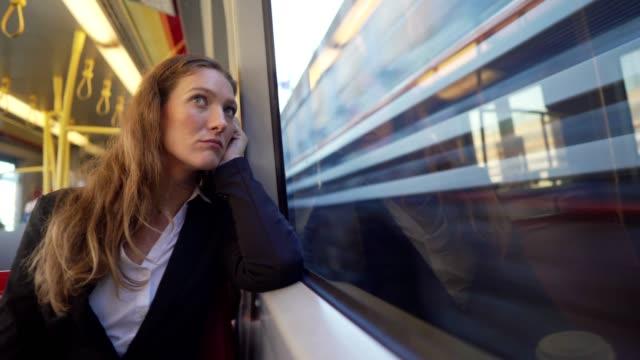 businesswoman traveling by the train - nuda filmów i materiałów b-roll