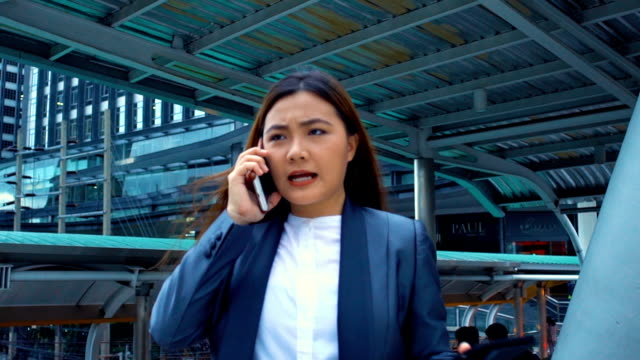 Businesswoman use a phone in a city,slow motion video