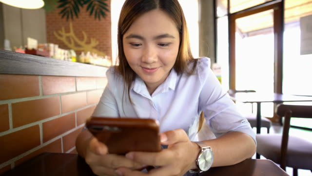 Businesswoman use smart phone at cafe video