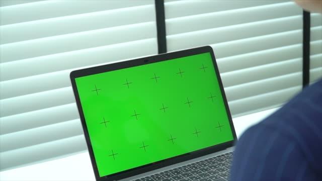 Businesswoman using computer green screen