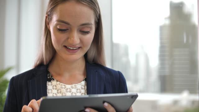 Video Businesswoman Using Digital tablet