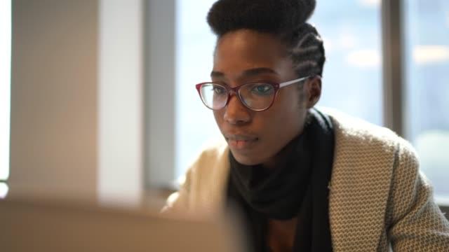 Businesswoman using laptop at work Businesswoman using laptop at work student stock videos & royalty-free footage