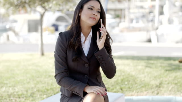 Businesswoman Using Phone On The Street video