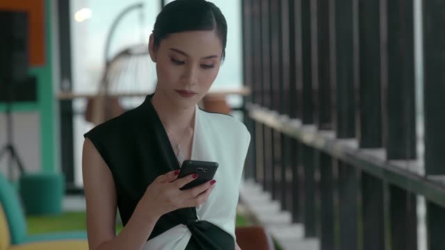 Businesswoman using phone