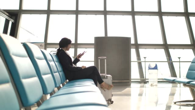 Businesswoman using Smart phone at Airport Businesswoman using Smart phone at Airport multimedia stock videos & royalty-free footage