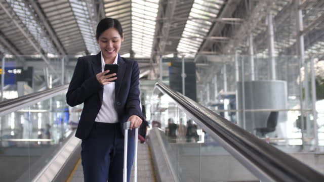 businesswoman using smart phone at airport - business travel stock videos and b-roll footage