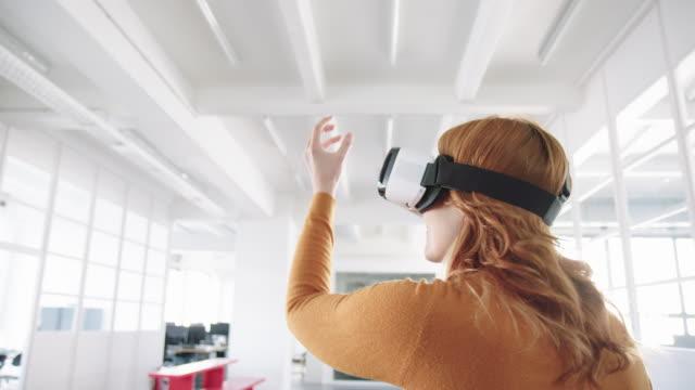 Businesswoman using VR headset glasses