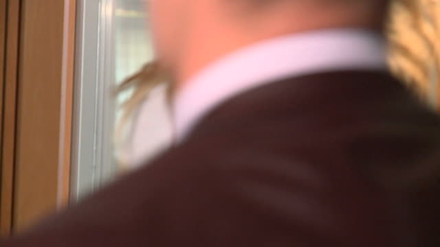 HD SLOW-MOTION: Businesswoman HD720p: SLOW-MOTION shot of a beautiful businesswoman leaning on the wall of an office building and looking at the camera with a big smile. In the blurred front people are passing by. leaning stock videos & royalty-free footage