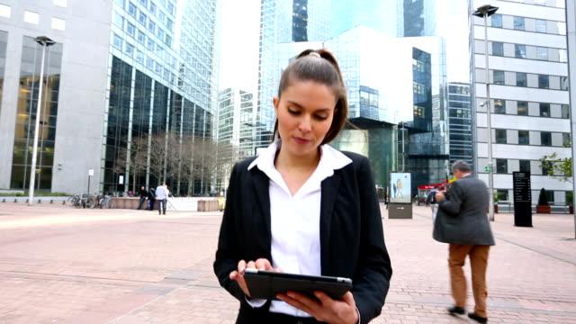 Businesswoman walking in Financial district, HD movie (1920X1080, 25 fps) video