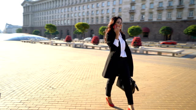 businesswoman walking in the city center. - business suit stock videos & royalty-free footage