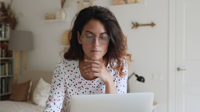 Businesswoman wear glasses searching new solutions while working on laptop
