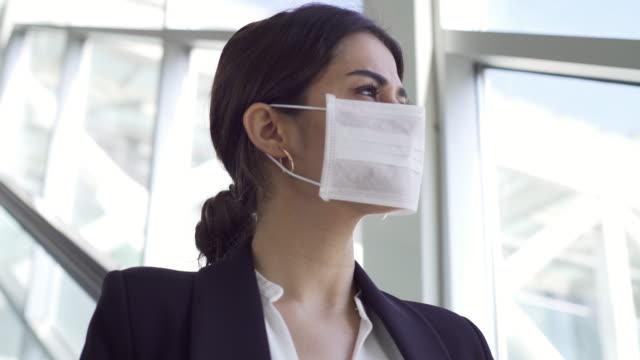 Businesswoman wearing a mask video