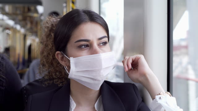 businesswoman wearing a mask while traveling - face mask stock videos & royalty-free footage