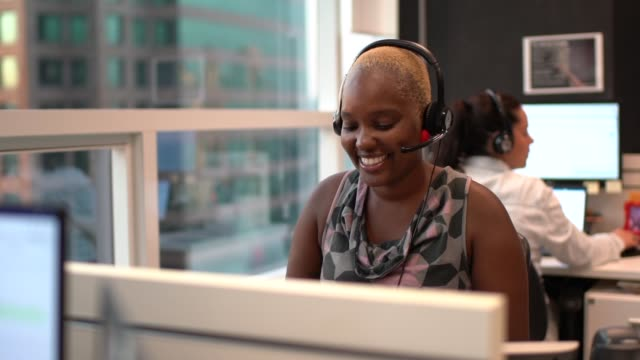 Businesswoman wearing headset in office callcenter Businesswoman wearing headset in office callcenter call center stock videos & royalty-free footage
