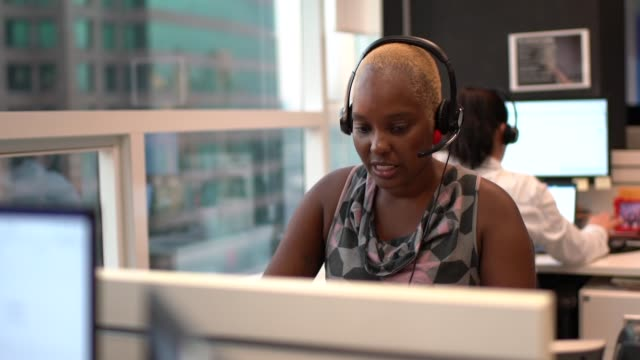Businesswoman wearing headset in office callcenter Businesswoman wearing headset in office callcenter bluetooth stock videos & royalty-free footage