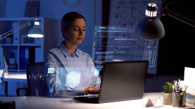 businesswoman with laptop and virtual screen business, deadline and technology concept - businesswoman with laptop computer and virtual screen projection working at dark night office hologram stock videos & royalty-free footage
