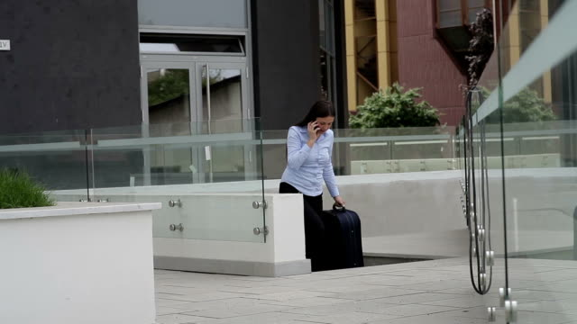 Businesswoman with suitcase video