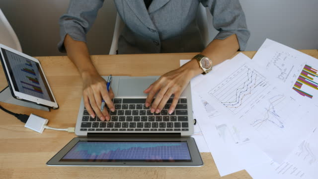Businesswoman working at office desk, Top view video