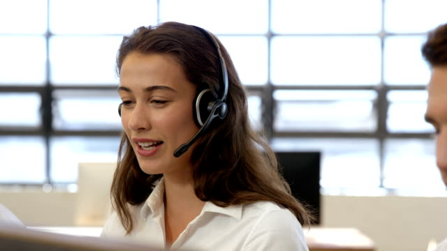 Businesswoman working in call center video