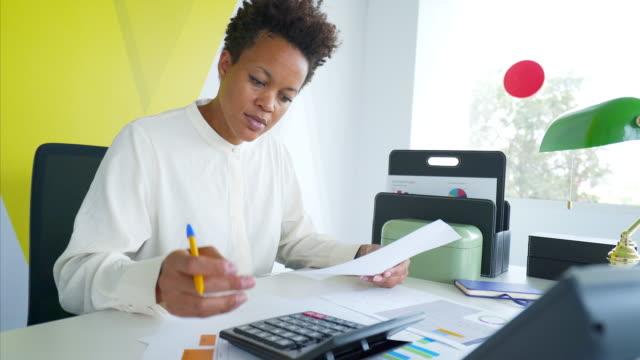 Businesswoman working in office.