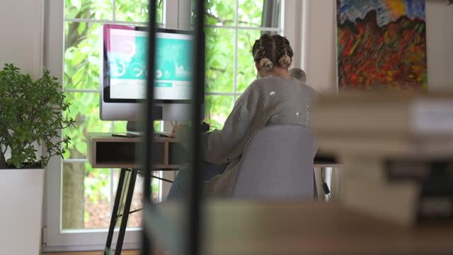 Businesswoman working on computer video