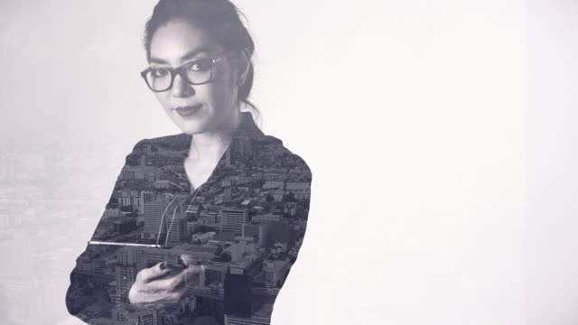 4K : Businesswoman working on digital table and city view. video