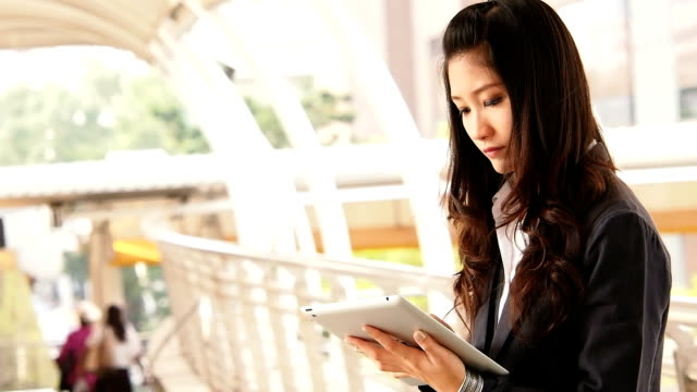 Businesswoman working on digital tablet video